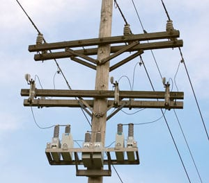 Capacitors improve the power factor on the utility lines — they prevent power from being wasted and help boost the voltage on long, rural distribution lines. Sources: Shelby Energy Cooperative, United Utility Supply