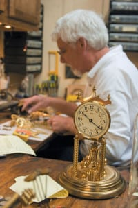 A customer's clock awaits its turn on Howell Rust's workbench. Rust estimates that he repairs 60 to 70 clocks each month, and the average turnaround time is six to eight weeks.