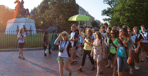 Washington Youth Tour participants follow the highly visible umbrella of their guide as they pass the statue of Andrew Jackson in Lafayette Square to view the White House.
