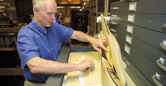 """Paul Clements examines documents at the Metropolitan Government Archives in Nashville. His expansive """"Chronicles of the Cumberland Settlements"""" compiles first-person accounts on the settlement of Middle Tennessee."""