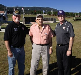 From left, Sequatchie County Veterans Memorial Park Board President Tommy Hickey and board members James Kelly and Johnny Cordell pose in front of the monument.