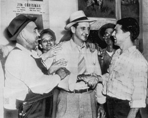 Former GI and newly elected McMinn County Sheriff Knox Henry, center, is congratulated on his victory after the Battle of Athens. Photograph courtesy of the Tennessee State Library and Archives