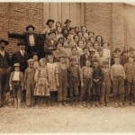 "These photographs by Lewis Hine show child laborers at the Elk Cotton Mills in Fayetteville. Above, the associated caption reads, ""The whole force in Elk Cotton Mills. Tiny boy in white waist on extreme left, 'Just helps his mother,' the superintendent said. Next boy is Leo, with a 'steady job.'"" And below: ""Young doffers in Elk Cotton Mills."""