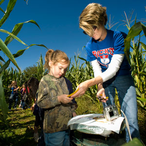 Children answer questions to get clues to find their way out of a corn maze. Photo by Drew McMurtrie, Tennessee Photographic Services.