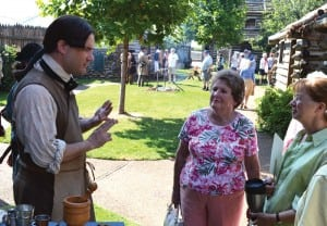 Visitors hear stories about pioneer life in Nashville from an interpreter at Fort Nashborough, which for years hosted historical, educational programming.