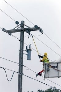 A co-op lineman fuses a line following a series of destructive winter storms. Linemen faced brutally cold weather during the restoration efforts.