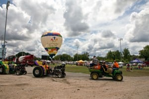 The open Modified Mini Tractors get a tow to the start line. The TSE balloon will be on hand again this year to give spectators a free tethered balloon ride if weather permits.
