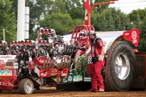 Bret Berg backs into position to hook to the sled in LGSeeds Moneymaker in the Modified Division. The tractors sport Allison Aircraft or Jet turbine engines.