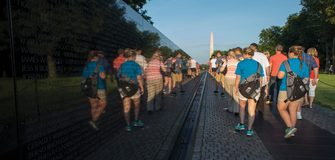Tennessee's Youth Tour group passes in hushed silence along the wall of the Vietnam Veterans Memorial toward the Washington Monument.