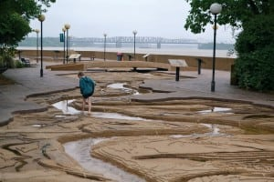 A visitor wades through Mud Island's re-creation of the river's route.