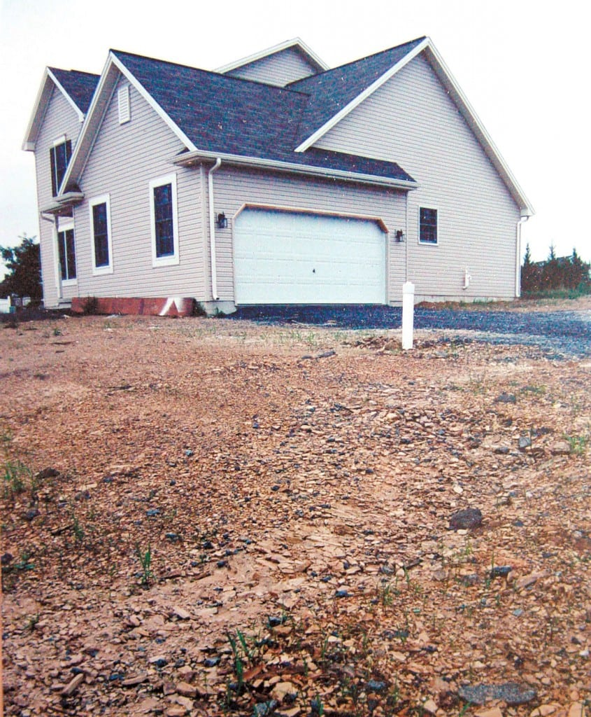 The future owners of this new home may not realize that this compacted shale soil is lurking below.