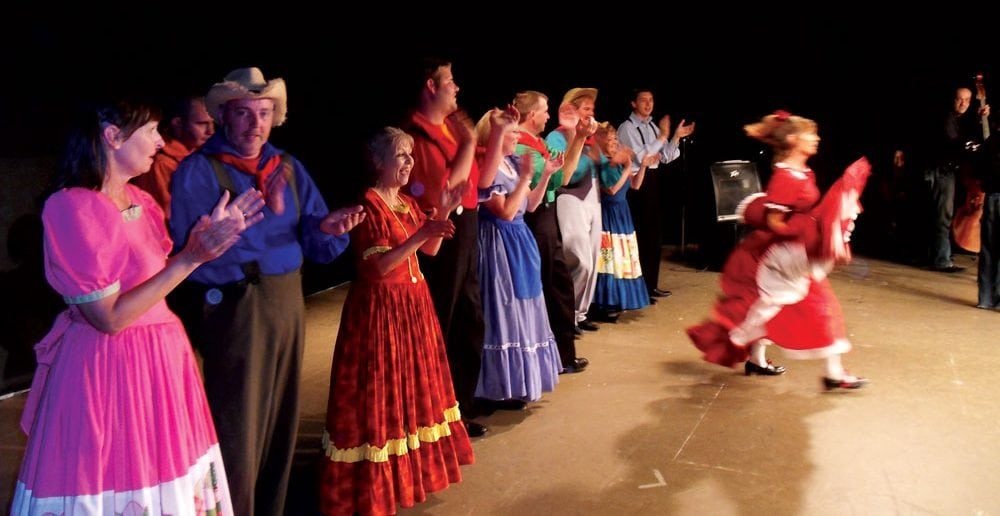 Cripple Creek Cloggers in their traditional costumes greet the audience.