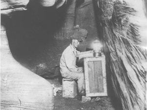 James Lewis in the chart room in Nickajack Cave where Lawrence S. Ashley had studied and charted the cave before beginning his exploration. Ashley became lost in the cave in 1927. Courtesy of the Tennessee State Library and Archives