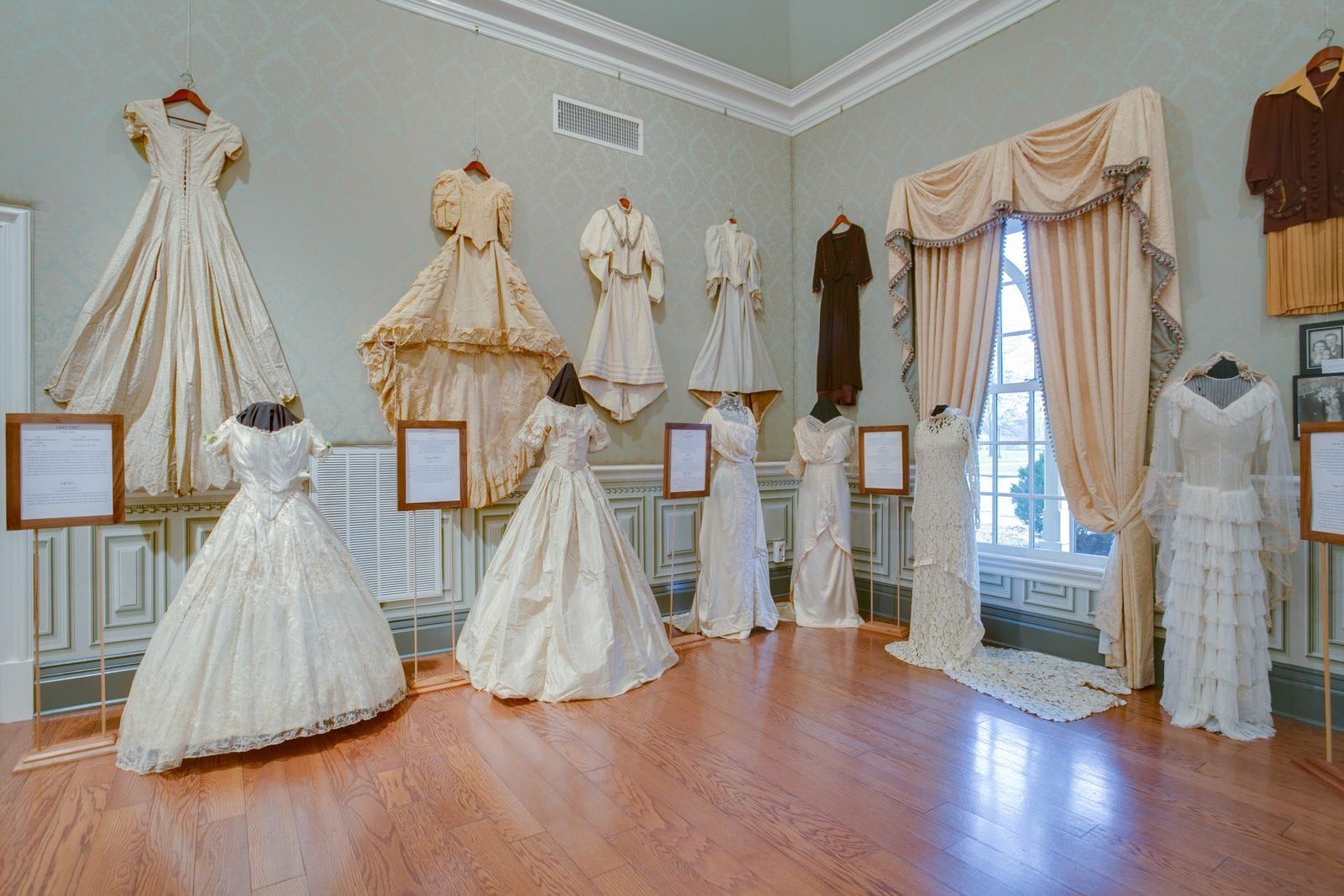 Wedding dresses through the decades exhibit at oaklands for Wedding dress display at home