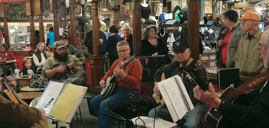 Members of the Jackson Area Plectral Society play Oldtime music in the ice cream parlor at Casey Jones Village. Photo by Doyle Freeman, courtesy of the Jackson Area Plectral Society