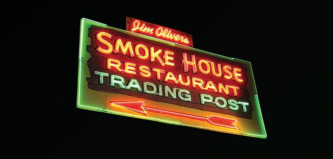 The well-known sign at The Smokehouse serves as a beacon to the local and traveler alike who wants good cooking and live music in a friendly environment.