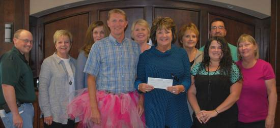 """Bedford Cancer Foundation representatives receive a check for the """"real Men Wear Pink"""" fundraiser from Shelbyville Times-Gazette Publisher High Jones."""