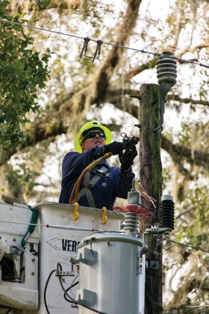 DREMC's Heath Nave helps restore power in Palatka, Florida.